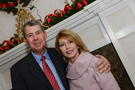 Table and Silent Auction Sponsors Bill and Carol Windsor at the Women's Refuge of Vero Beach's 2018 Christmas Banquet at Oak Harbor Club.