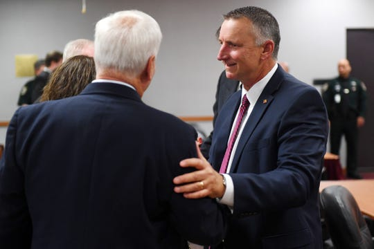 "Chief Assistant State Attorney Tom Bakkedahl (right) greets Mike Hadley on Thursday, Dec. 20, 2018 after a brief sentencing hearing for Tyler Hadley, who was convicted of murdering his parents in 2011. County Circuit Judge Gary Sweet sentenced Hadley to two life terms for the murder of his parents, Blake and Mary Jo. ""If Tyler Hadley doesn't deserve life in prison, then no one does,"" Bakkedahl said. ""There has to be finality, this has to be it, we cannot tolerate another resentencing of this nature. It is simply unfair to the victims and they've been left behind in the this process for the last eight years."""
