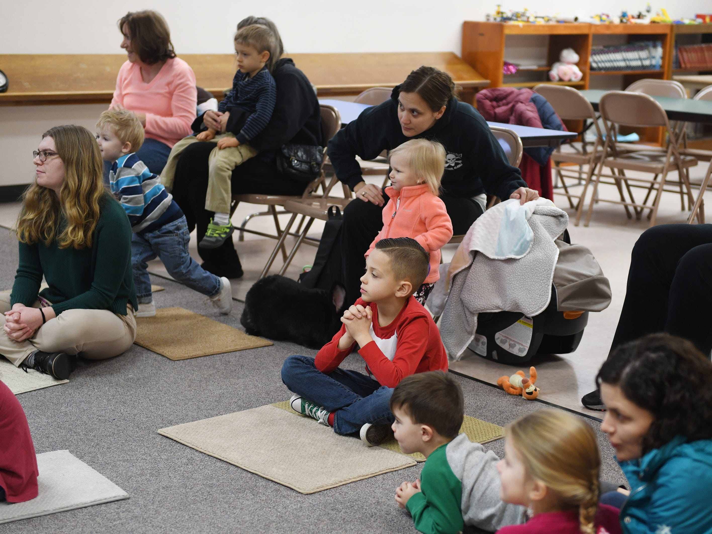 Kids enjoy Zoobrary time at the Bridgeton Public Library on Thursday, December 20. The free program gave preschool children the opportunity to learn about and meet live zoo animals along with story telling by Cohanzick Zoo zookeeper Alison Bohn.