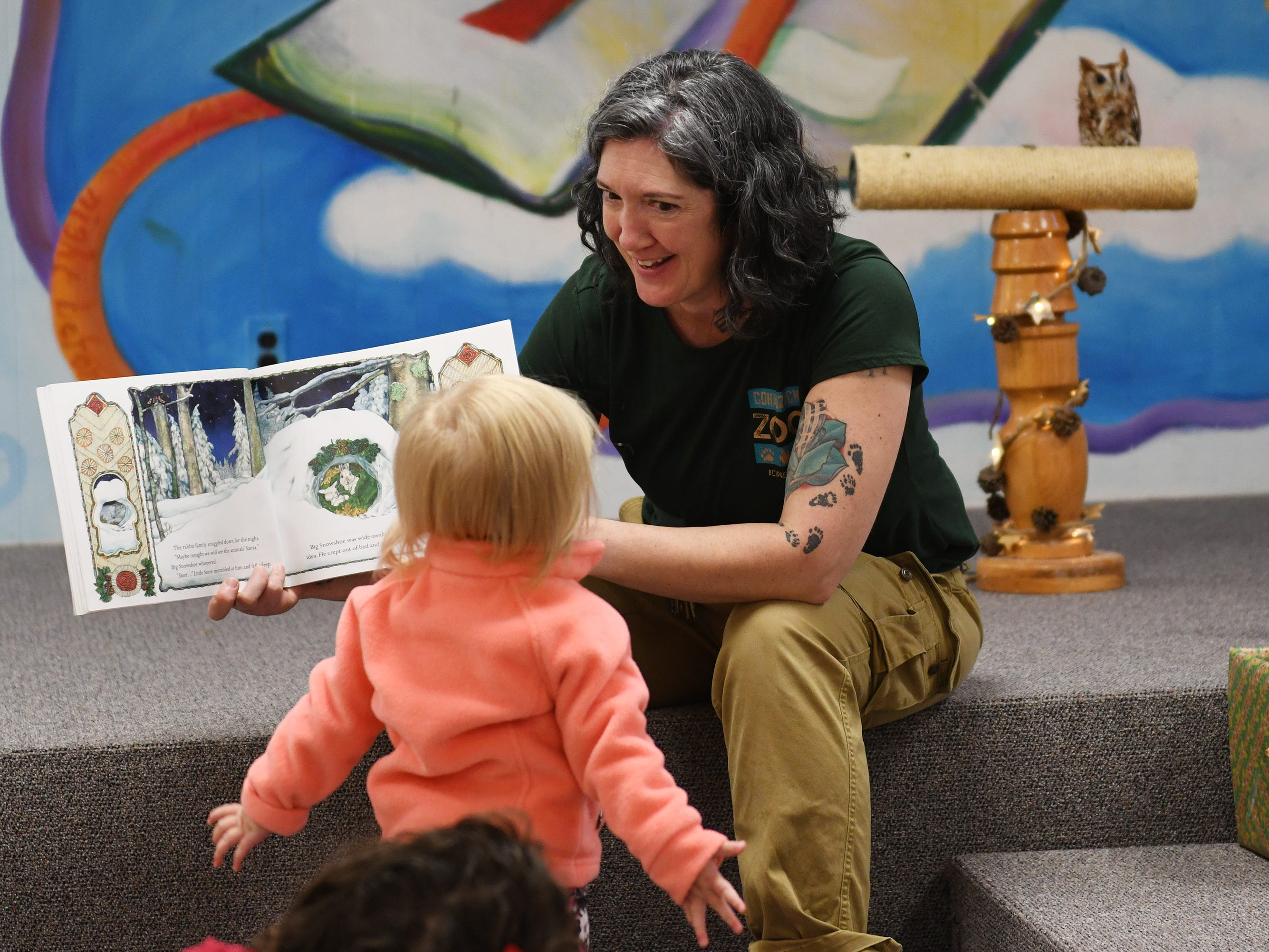Cohanzick Zoo zookeeper Alison Bohn reads The Animals' Santa during Zoobrary time at the Bridgeton Public Library on Thursday, December 20, 2018.