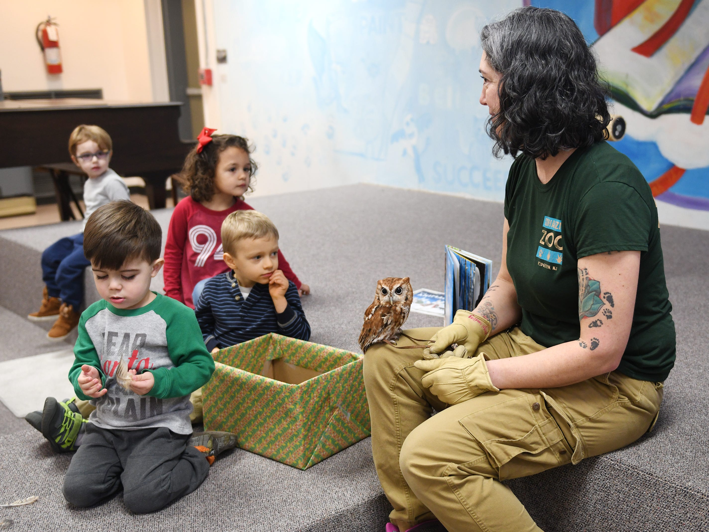 Cohanzick Zoo zookeeper Alison Bohn shows off a screech owl named Wisp William during Zoobrary time at the Bridgeton Public Library on Thursday, December 20, 2018.