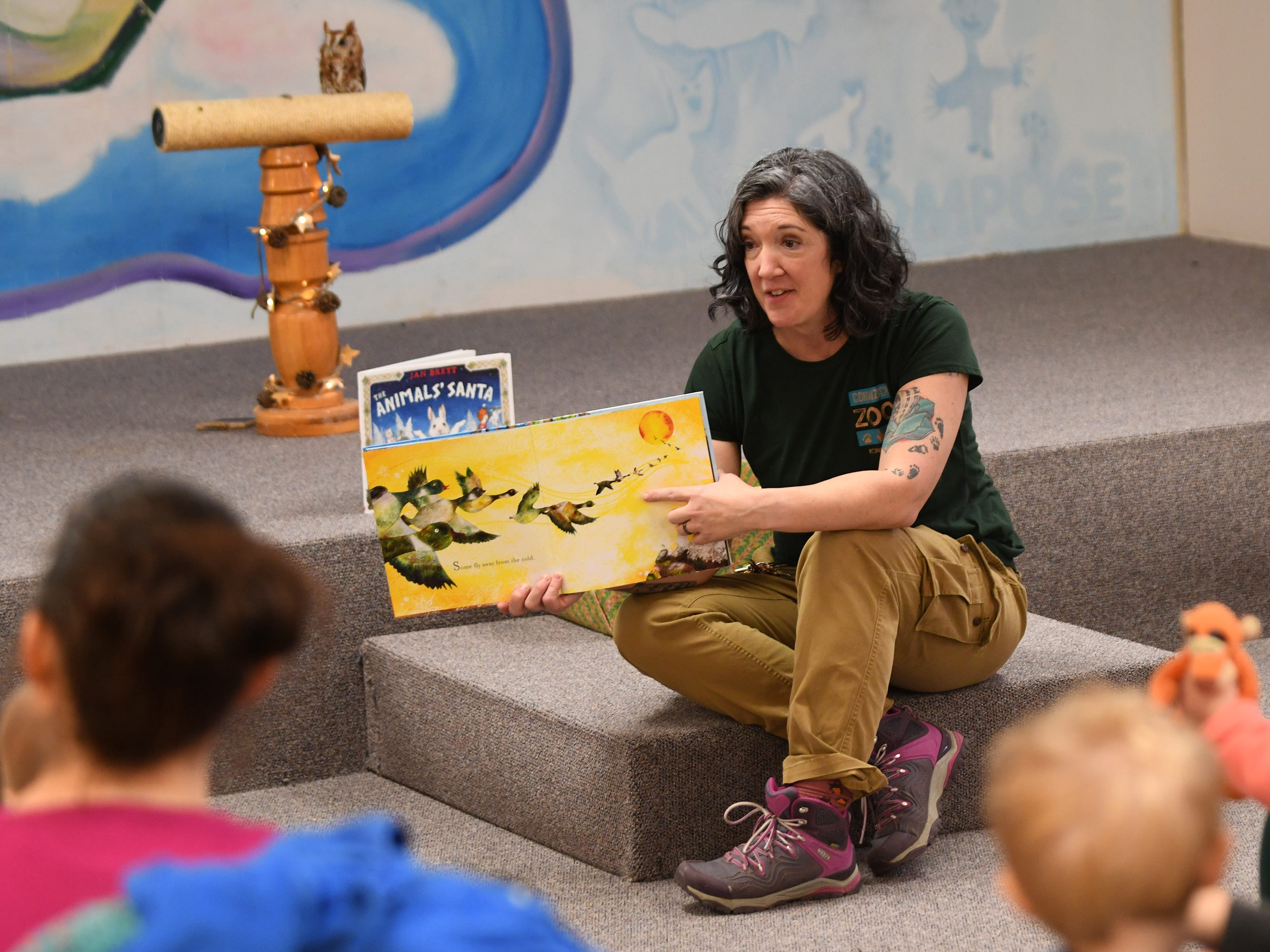Cohanzick Zoo zookeeper Alison Bohn reads Snow Rabbit, Spring Rabbit during Zoobrary time at the Bridgeton Public Library on Thursday, December 20, 2018.