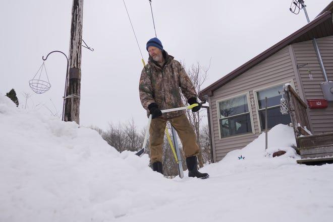 Matt King, 62, shovels snow outside his Hurley home.