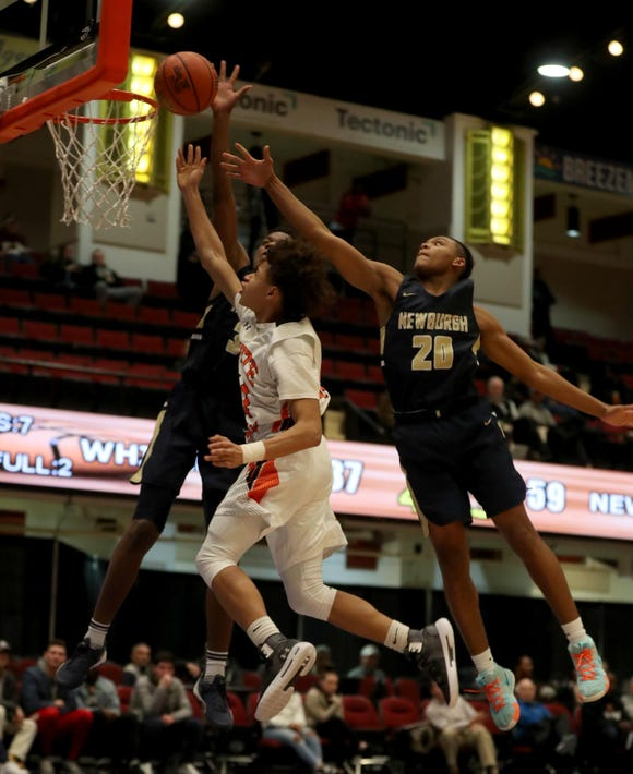 Tymir Greene of White Plains has a shot contested during a Slam Dunk Tournament basketball game against Newburgh Free Academy at the Westchester County Center Dec. 19, 2018. The Newburgh Free Academy defeated White Plains 70-48.