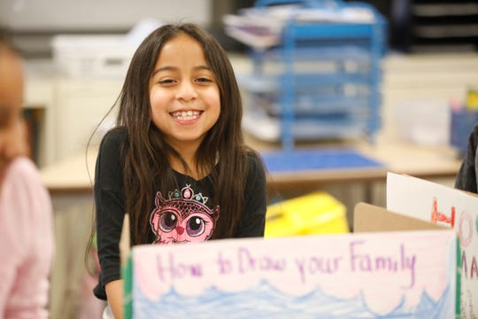Brianna Melendez, 7, a 4th grader at the Richard P. Connor elementary school in Suffern gets ready to make a presentation at a reading museum walk on Dec. 20, 2018.  The program promotes reading and writing with positive reinforcement with sharing work with other students in the school.