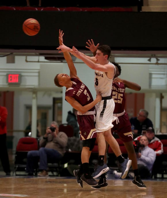 Sam Goldman of Byram Hills passes while being pressured by Brandan Upshaw of Iona Prep during a Slam Dunk Basketball Tournament game at the Westchester County Center Dec. 19, 2018. Iona Prep defeated Byram Hills 43-41.