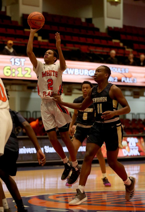 Eisaiah Murphy of White Plains shoots  during a Slam Dunk Tournament basketball game against Newburgh Free Academy at the Westchester County Center Dec. 19, 2018. The Newburgh Free Academy defeated White Plains 70-48.