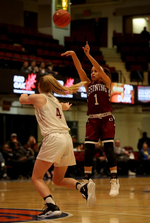 Jaida Strippoli of Ossining shoots over Sierra Linnen of Albertus Magnus during a Slam Dunk Basketball Tournament game at the Westchester County Center in White Plains Dec. 20. 2018. Ossining defeated Magnus 76-65.