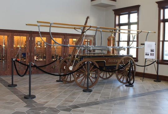 Peekskill's antique piece of fire apparatus is on display at the new central firehouse.