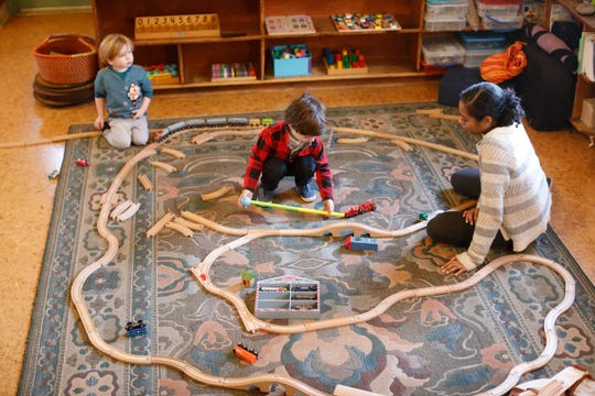 Children build a train set at the Peace through Play Nursery school in Chestnut Ridge on Dec. 20, 2018.