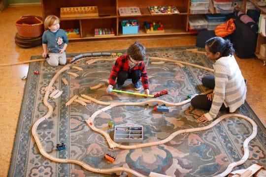 Children build a train set at the Peace through Play Nursery school in Chestnut Ridge on Dec. 20, 2018.