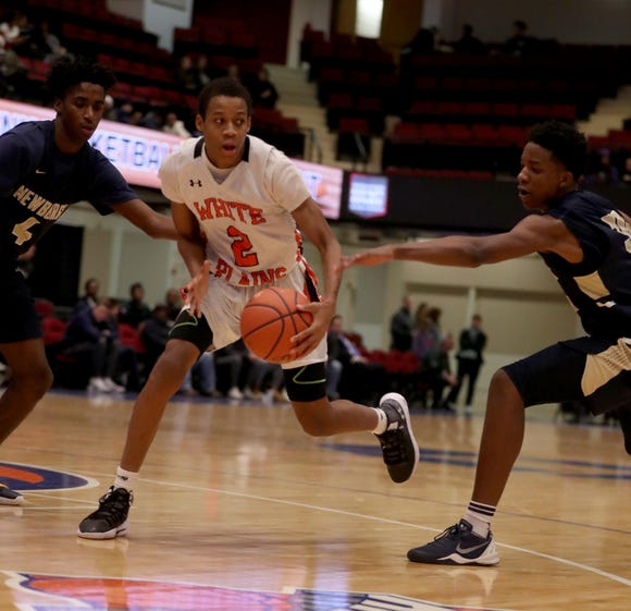 Eisaiah Murphy of White Plains is defended  during a Slam Dunk Tournament basketball game against Newburgh Free Academy at the Westchester County Center Dec. 19, 2018. The Newburgh Free Academy defeated White Plains 70-48.