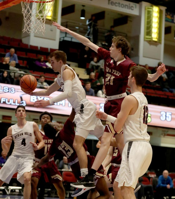 Willy Samsen of Byram Hills drives on Ronald Greene Jr. of Iona Prep during a Slam Dunk Basketball Tournament game at the Westchester County Center Dec. 19, 2018. Iona Prep defeated Byram Hills 43-41.