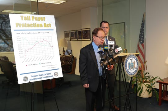 State Assemblyman Tom Abinanti, D-Mount Pleasant, at microphones, and state Sen. David Carlucci, D-New City, hold a Dec. 20 news conference in Tarrytown to discuss the Toll Payer Protection Act.