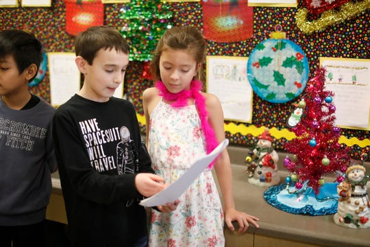 Brayden Gutterman, 8, a 4th grader and Layla Flores, 7, a 2nd grader at the Richard P. Connor elementary school in Suffern talk about Flores presentation during reading museum walk on Dec. 20, 2018.  The program promotes reading and writing with positive reinforcement by sharing work with other students in the school.