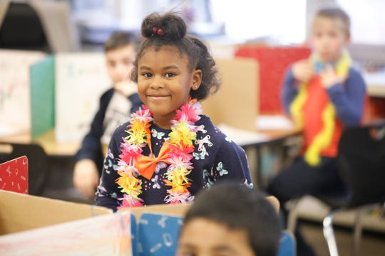 Saira Malivert, 4, a 2nd grader at the Richard P. Connor elementary school in Suffern gets ready to show her work to other students at a reading museum walk on Dec. 20, 2018.  The program promotes reading and writing with positive reinforcement by sharing work with other students in the school.