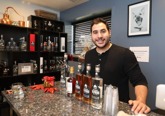 Vincent Miata, the proprietor of the Good Shepherd Distillery in Mamaroneck, is pictured with some of the crafted items for sale, Dec. 20, 2018.