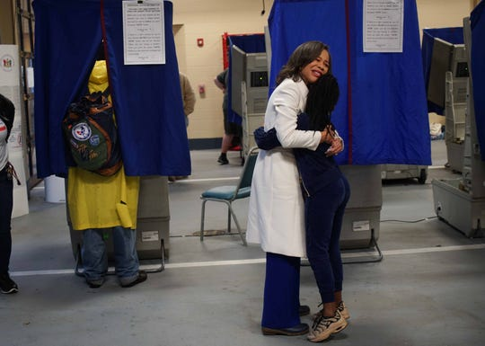 Rep. Lisa Blunt Rochester gives a young child a hug after she cast her own votes for the midterm election on Tuesday morning at the Brandywine Hundred Fire Company.