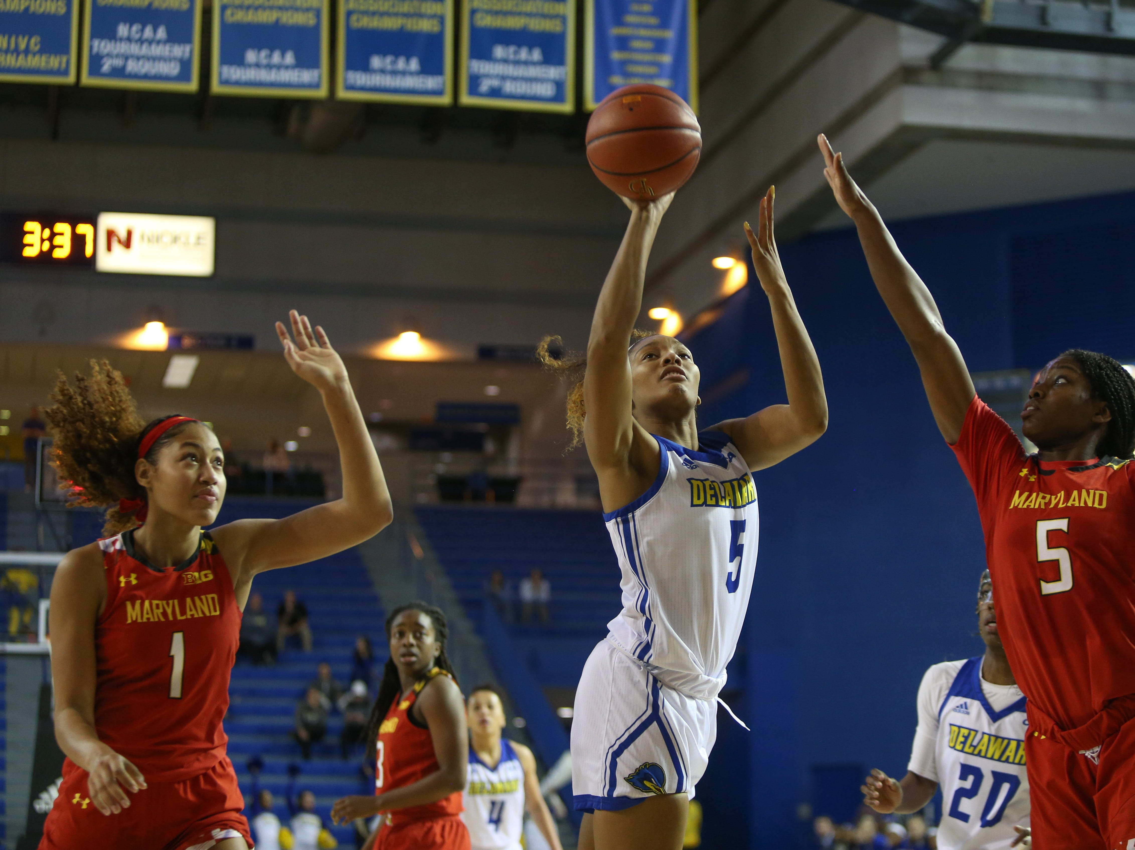 Delaware captain Makeda shots from the key as Maryland's Shakira Austin, left, and Kaila Charles look on. Nicholas The University of Delaware women's basketball team takes on No. 5 University of Maryland at the Bob Carpenter Center Thursday.