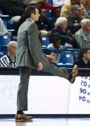 Delaware head coach Martin Ingelsby watches his team play in the second half of Delaware State's 73-71 win at the Bob Carpenter Center Wednesday.