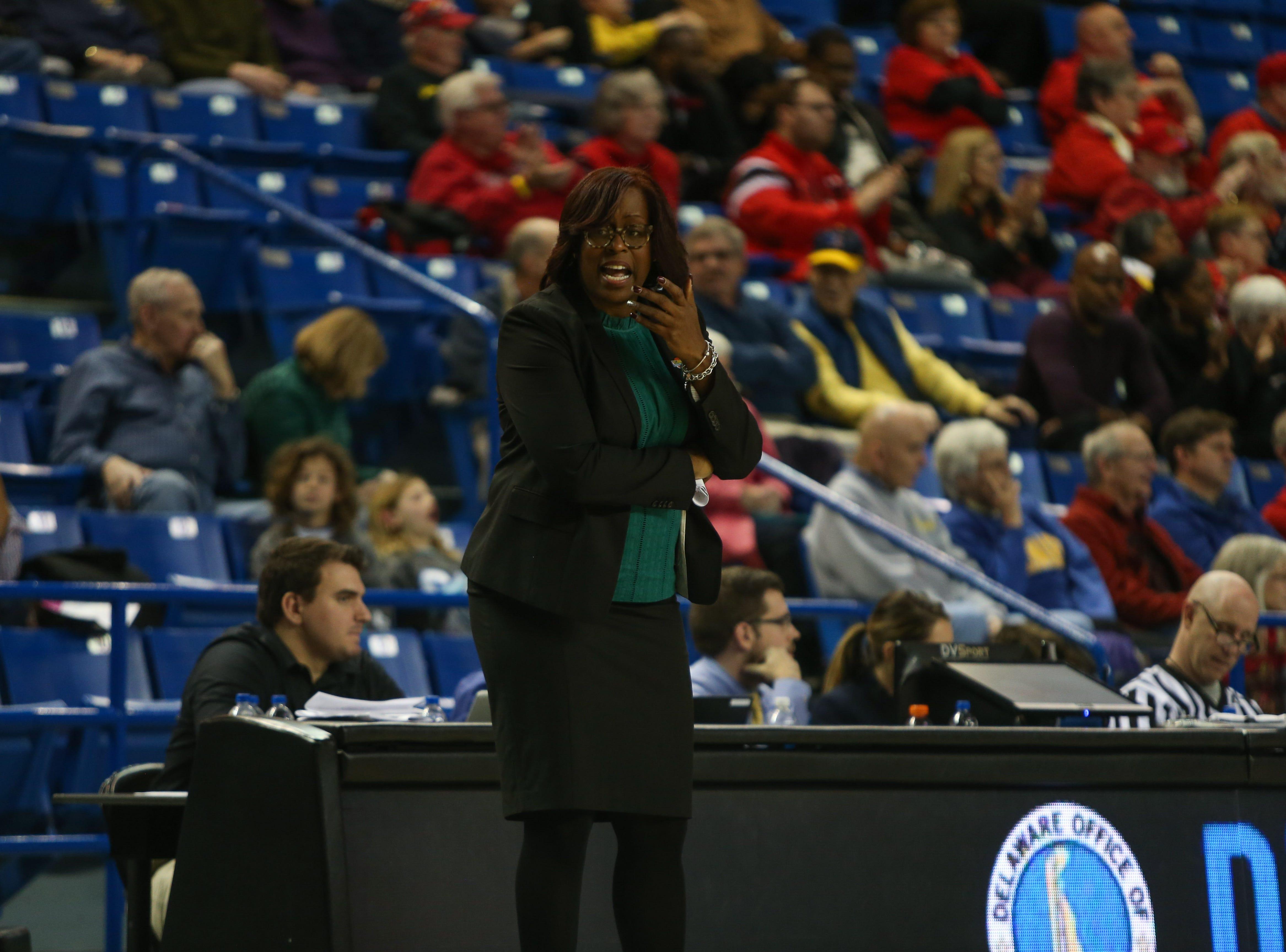 Delaware coach Natasha Adair reacts to a Maryland basket. The University of Delaware women's basketball team falls to No. 5 University of Maryland 77-53 at the Bob Carpenter Center Thursday.