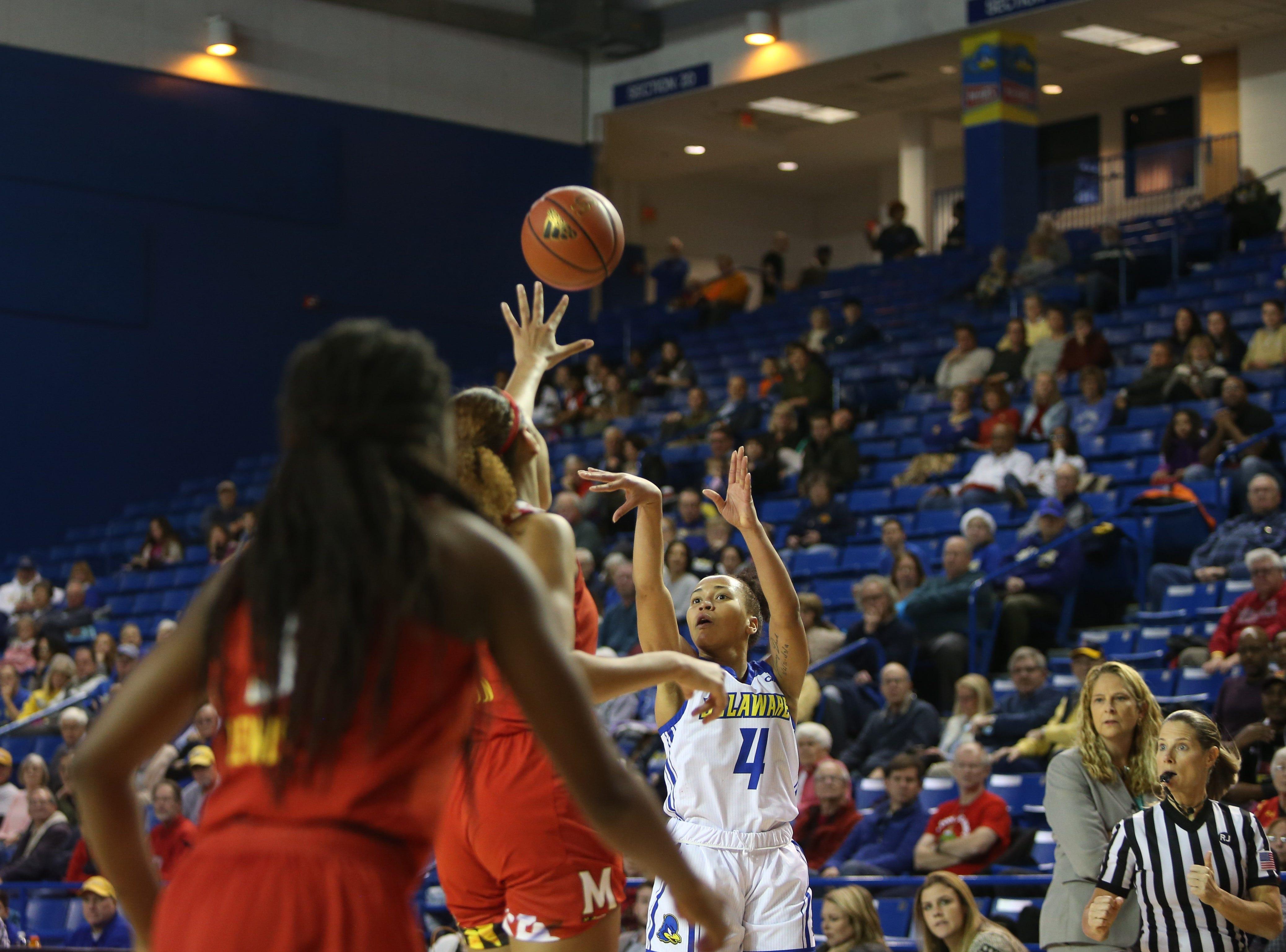 Delaware freshman guard Paris McBride shoots over the Maryland defense. The University of Delaware women's basketball team takes on No. 5 University of Maryland at the Bob Carpenter Center Thursday.