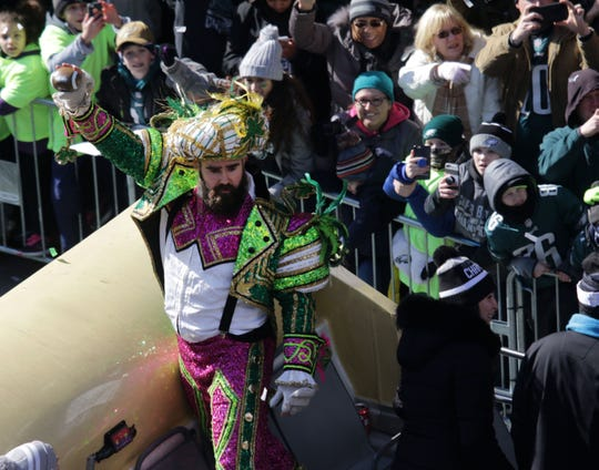 Eagles Jason Kelce dressed in a Mummers outfit while riding in Philadelphia Eagles parade celebrating their Super Bowl LII victory on Thursday.