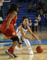Delaware guard Paris McBride changes direction on Maryland's Channise Lewis. The University of Delaware women's basketball team takes on No. 5 University of Maryland at the Bob Carpenter Center Thursday.