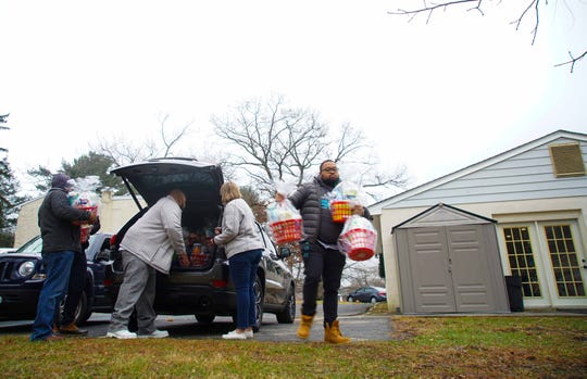 Volunteers unload gifts for residents staying at Family Promise of Northern New Castle County, a shelter for families that have experienced homelessness.