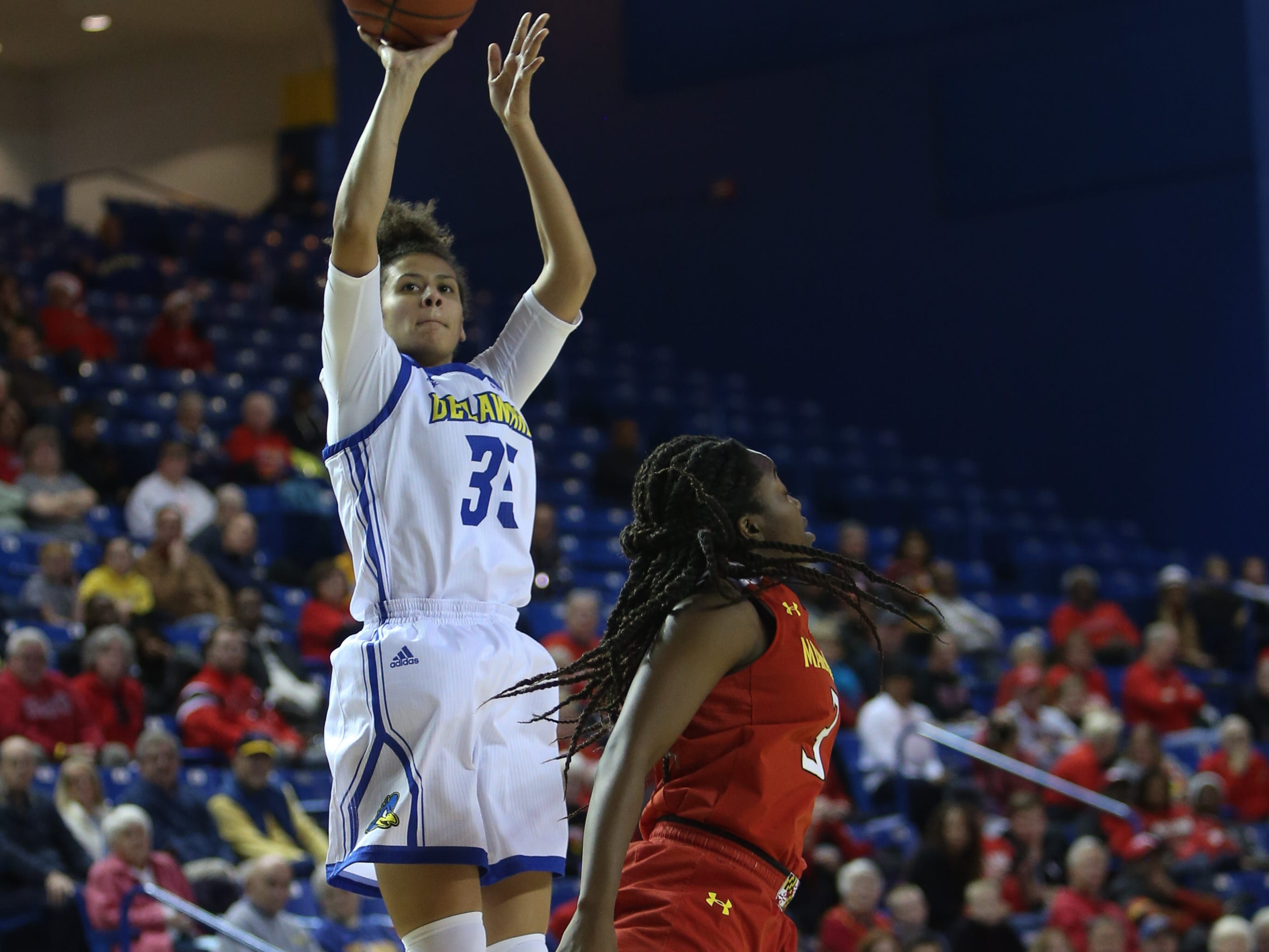 Delaware guard Alison Lewis rises up for two over Maryland guard Channise Lewis. Delaware The University of Delaware women's basketball team falls to No. 5 University of Maryland 77-53 at the Bob Carpenter Center Thursday.