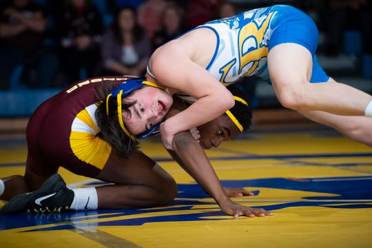 Caesar Rodney's Michael Primo (right) and Milford's Timothy O'Hara tangle during a match earlier this season. CR earned the No. 2 seed in the DIAA Division I Dual Team tournament, while Milford is the No. 1 seed in the Division II bracket.