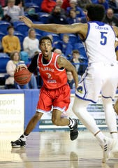 Delaware State's Kevin Larkin looks past Delaware's Eric Carter in the second half of Delaware State's 73-71 win at the Bob Carpenter Center Wednesday.