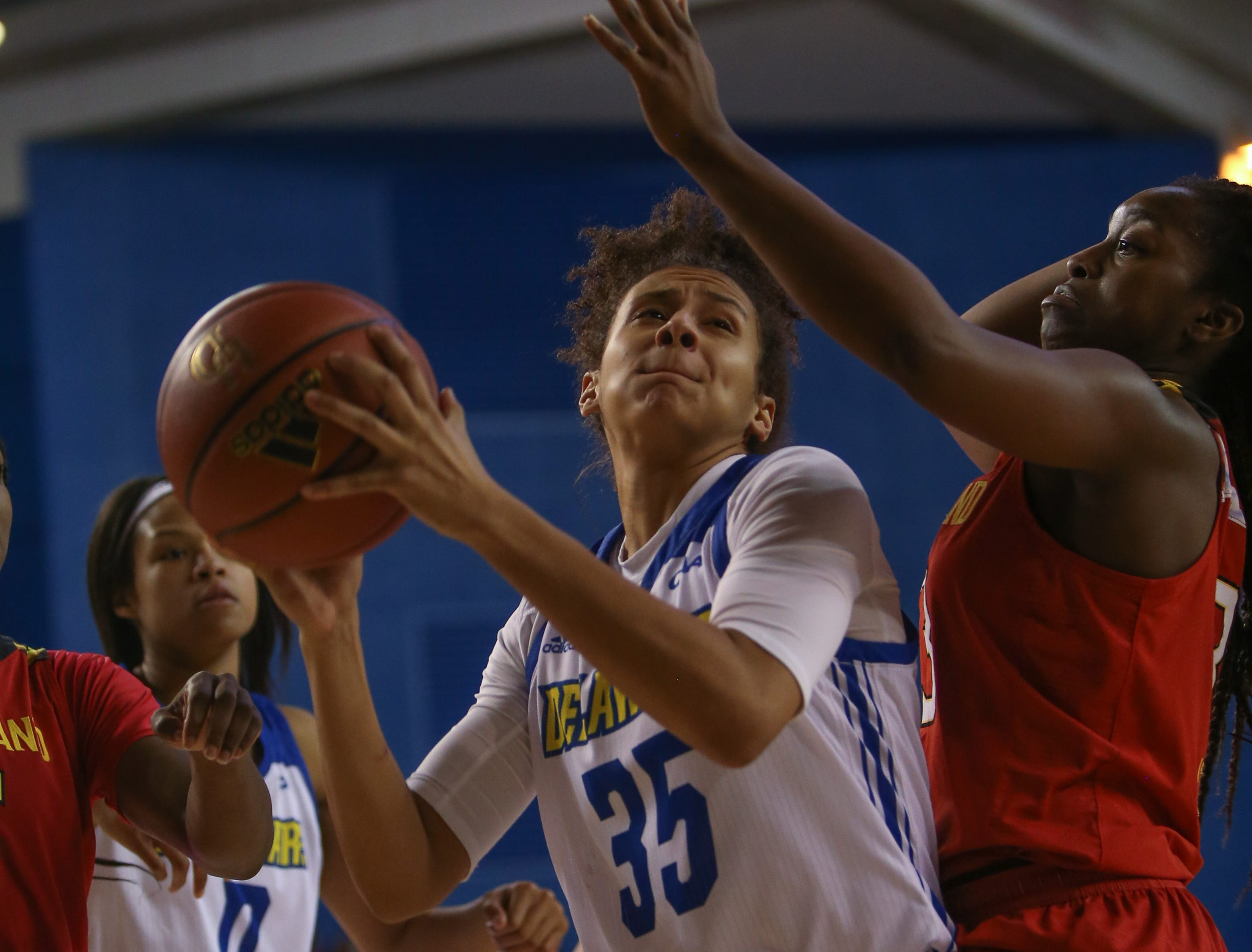 Delaware guard Alison Lewis secures the rebound. The University of Delaware women's basketball team falls to No. 5 University of Maryland 77-53 at the Bob Carpenter Center Thursday.