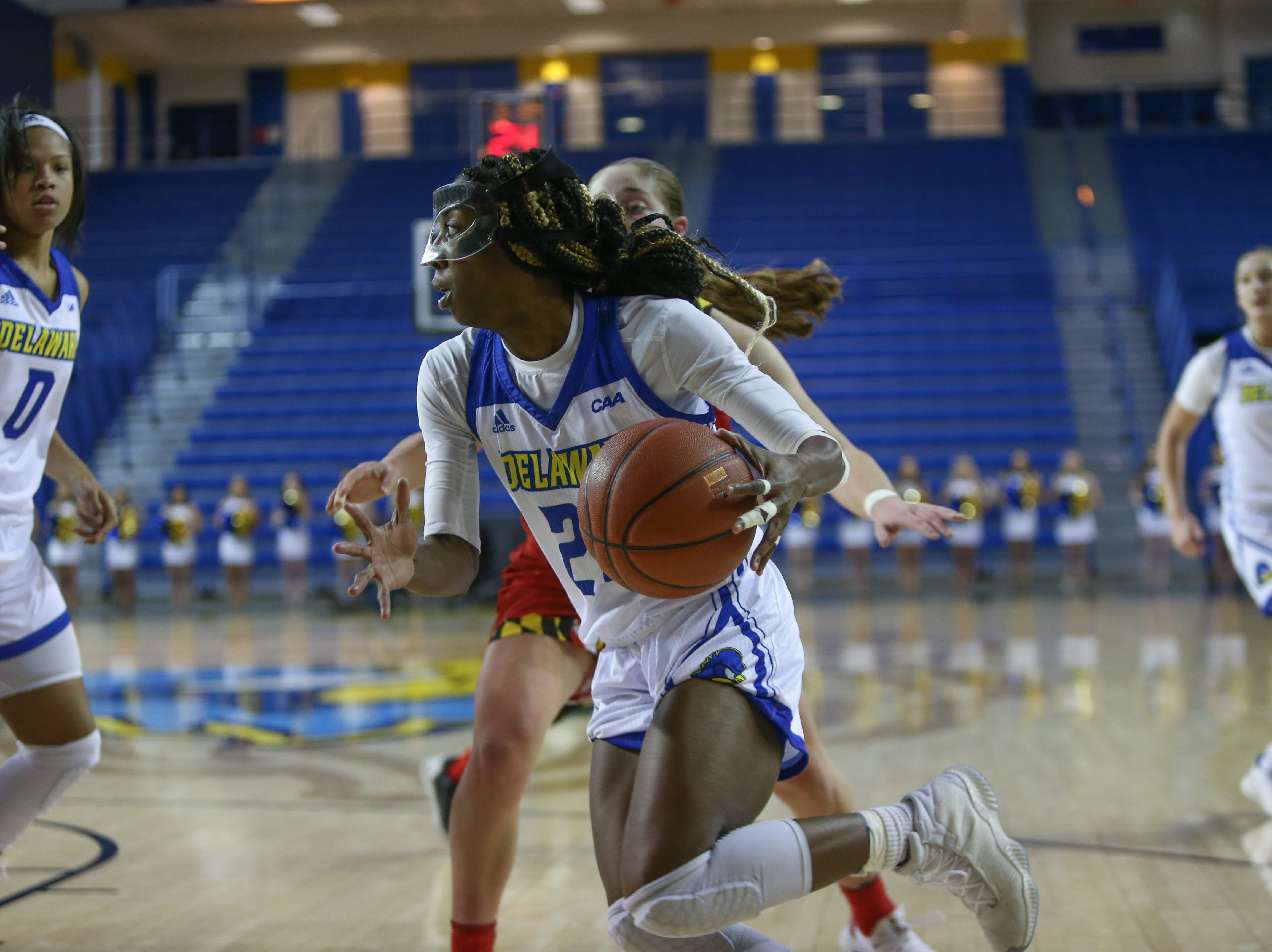 Delaware guard Jasmine Dickey drives to the basket in the third quarter against Maryland. The University of Delaware women's basketball team falls to No. 5 University of Maryland 77-53 at the Bob Carpenter Center Thursday.