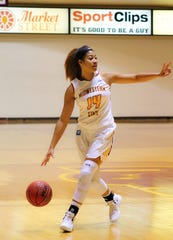 Kityana Diaz calls out a play as she dribbles the ball. The Mustangs outscored UT Tyler 95-36.