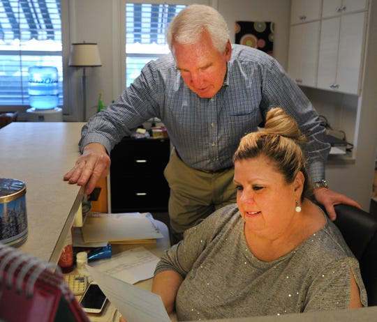 Wichita Falls private practice dentist Dr. John Thornton and his front office manager, Paulette Digby, walk through some last day paperwork before closing his practice of more than 32 years, Thursday afternoon.