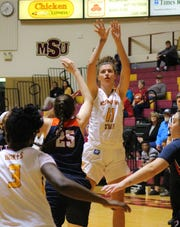 Hannah Reynolds shoots for the Mustangs. Reynolds led in points tonight with 19 points total.