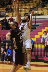 Bishop Coulter fights for the rebound against Oklahoma Christian's Will Lienhard. Coulter scored 10 points for the Mustangs tonight and 2 rebounds. The Mustangs broke a 6-game losing streak in their 88-82 victory tonight.
