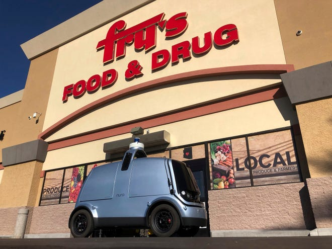 An autonomous vehicle called an R1 created to deliver groceries is displayed outside a Fry's grocery store, which is owned by Kroger Co., in Scottsdale, Ariz.,