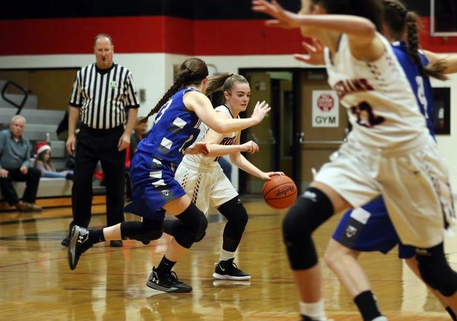 Rosecrans' Tessa Littick moves with the ball against Danville.