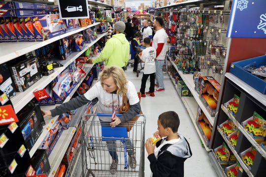 Shoppers filled the toy aisles of Walmart in Zanesville during a Christmas shopping trip with Kevin Martin Wednesday evening. Martin, a former NBA star and Zanesville graduate, purchased Christmas gifts for more than 100 youngsters.