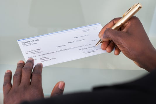 Businessman Filling Cheque