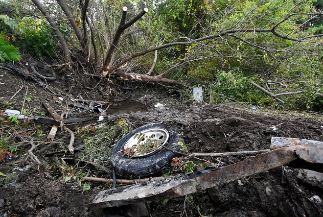 Debris scatters an area Oct. 7, 2018, at the site of a limousine crash the day before that killed 20 people.