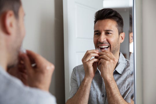 Clear-plastic teeth aligners are easily removed from the mouth for eating, drinking or romantic encounters. Teeth straightening startup Candid, a competitor to SmileDirectClub and Invisalign, provided this photo showing its aligners.