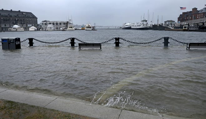 Ordinarily a picturesque waterfront park, Christopher Columbus Park in Boston is flooded during a nor'easter storm on March 2, 2018. City officials plan to raise and armor the park so it can serve as a flood barrier to protect portions of the city's 47-mile-long coastline in preparation for stronger storms and higher tides fueled by climate change.