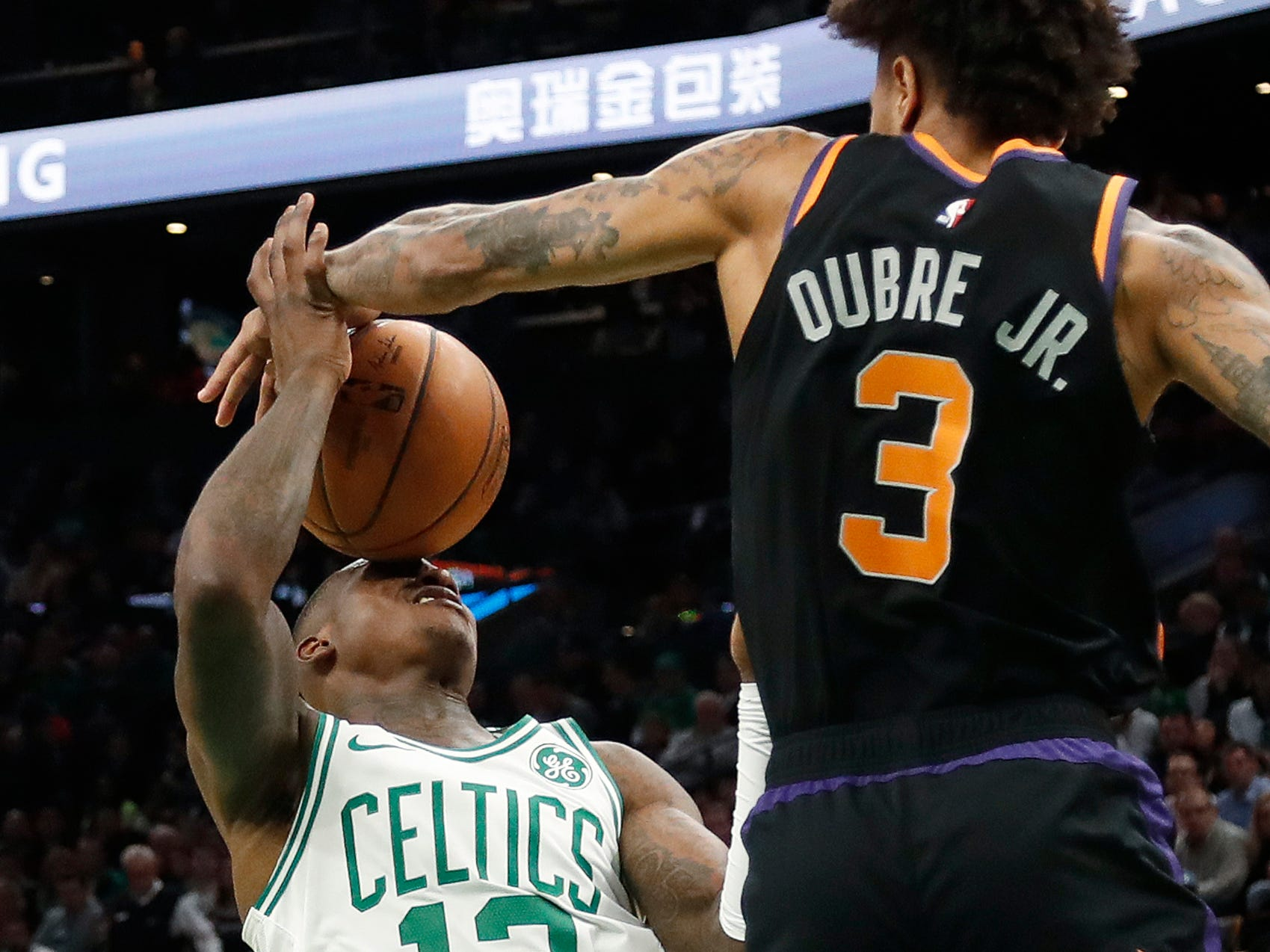 Dec. 19: Suns defender Kelly Oubre Jr. (3) blocks a shot right back into the face of Celtics guard Terry Rozier (12) during the second half in Boston.