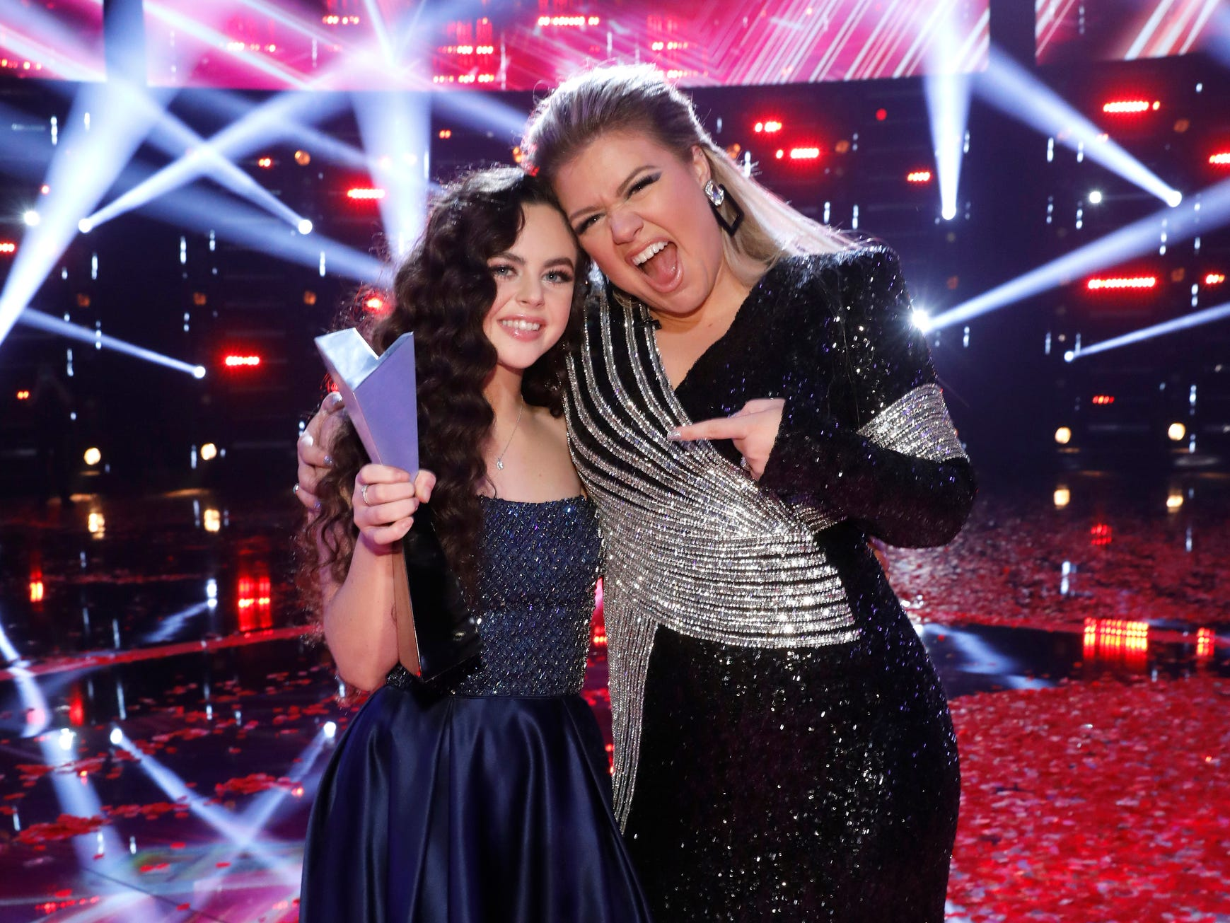 """This photo provided by NBC shows """"The Voice"""" finalist, Chevel Shepherd, left, for season 15, and singer Kelly Clarkson Tuesday, Dec. 18, 2018, in Universal City, Calif. (Trae Patton/NBC via AP) ORG XMIT: CAET502"""