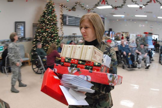 North Dakota: Senior Master Sgt. Sandi Renville carries Christmas gifts at the North Dakota Veteran's Nursing Home in Lisbon, N.D.