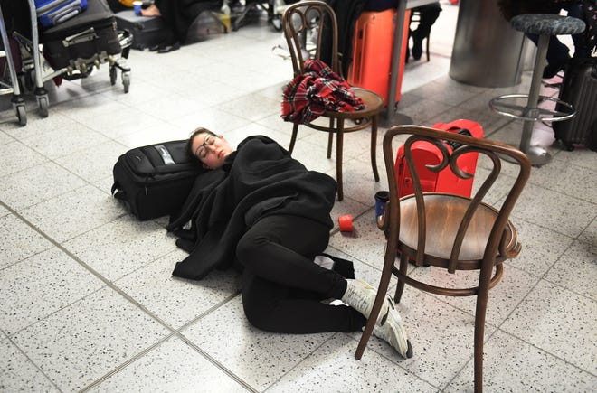 A passenger waits within Gatwick Airport in south London on Dec. 20, 2018. The runway for Gatwick Airport was shut down by authorities after sightings of drones flying near the airport.