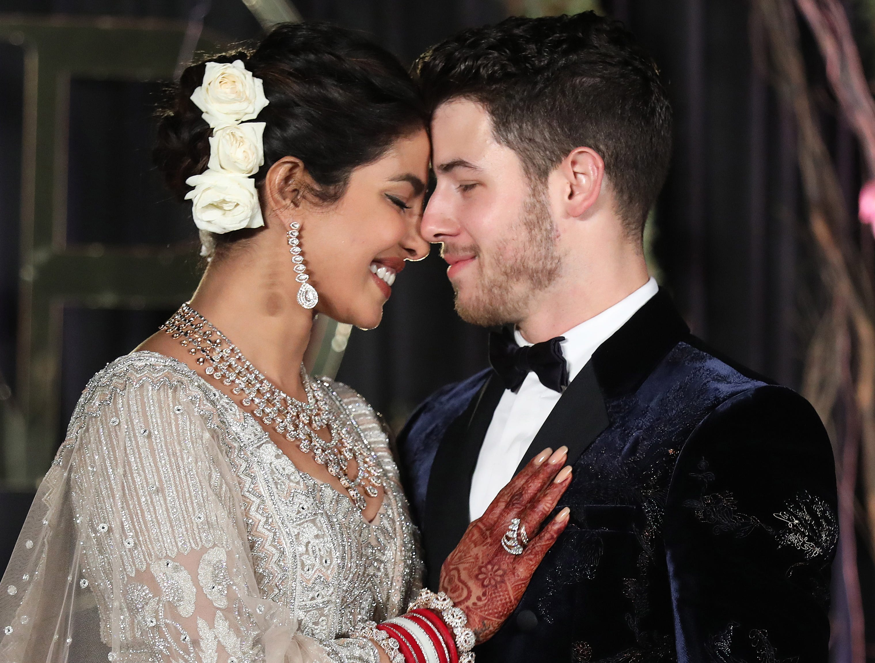 epa07208523 Newlyweds, Bollywood actress Priyanka Chopra (L) and US musician Nick Jonas (R) pose for photographs during a reception in New Delhi, India, 04 December 2018. According to media reports, the couple hosted wedding celebrations in Jodphur on 01 and 02 December.  EPA-EFE/RAJAT GUPTA